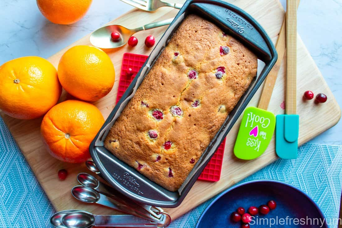 Baked Cranberry Orange bread loaf in the pan